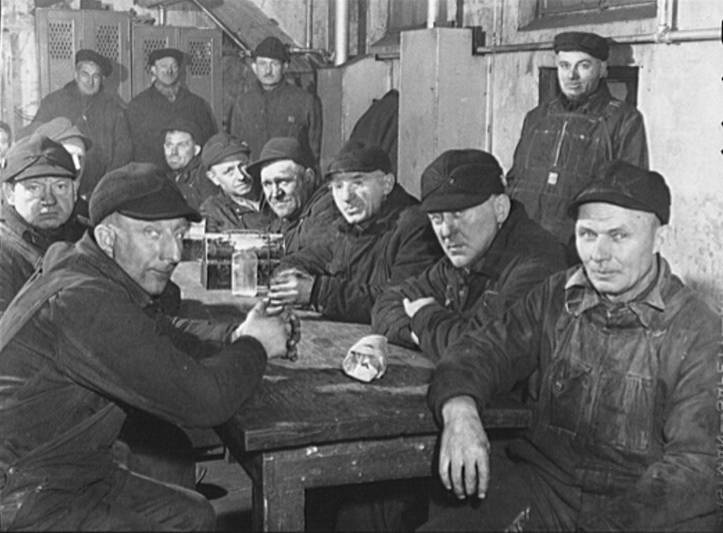 In 1942, photographer Jack Delano snapped this image of employees of Western Fuel Commpany having lunch in their locker room at the firm's Seventeenth Street Coal Dock office. It's December 1942, and World War II has been going on for a year. Somehow one feels they are waiting for the photographer to leave so they can resume the poker game. Photo courtesy Farm Security Administration - Office of War Information Photograph Collection (Library of Congress), [reproduction number, LC-USW3- 020002-D [P&P] LOT 214]