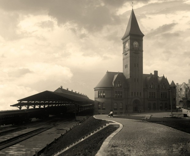 """This view of Chicago & North Western's lake front depot in Milwaukee was captured around 1890 by a photographer from the Detroit Publishing Company. Going by the angle of the sun and the station clock, it's 7:30 on a summer morning. The Romanesque building, once called """"the most elegant passenger station in the west,"""" was located at the foot of East Wisconsin Avenue, near what is today O'Donnell Park. Photo courtesy Library of Congress, Prints & Photographs Division, Detroit Publishing Company Collection, LC-DIG-det-4a04244"""