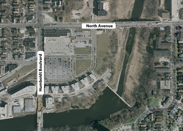 The area of the former North Avenue dam as it appears today. The river is much narrower above the dam and the former railroad shop complex is home to a Pick 'n' Save grocery store.