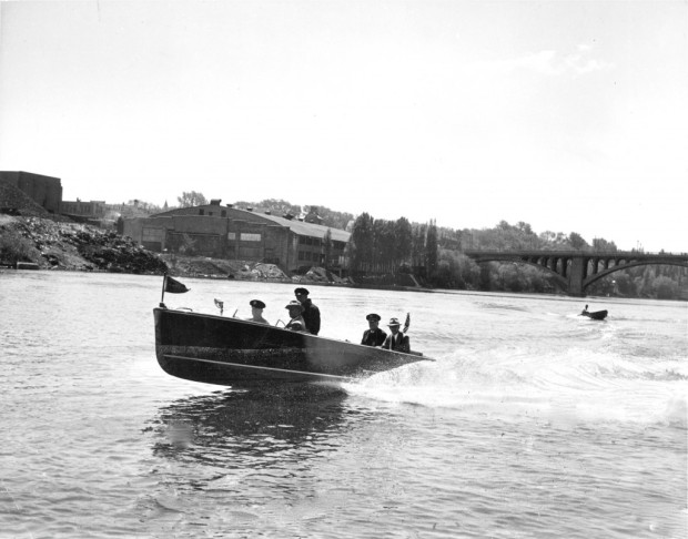 One of the earliest Milwaukee Police river patrol boats is shown at speed on the Milwaukee River north of the North Avenue Viaduct. This is probably the first of series of police boats, all named the Killjoy. Milwaukee Journal photo, Historic Photo Collection/Milwaukee Public Library
