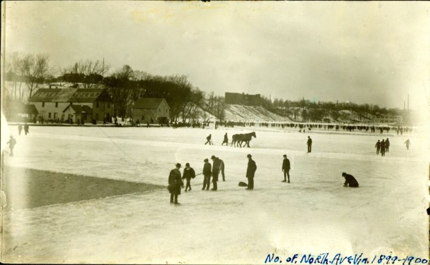 Workers cutting ice from the frozen Milwaukee River upstream of the North Avenue bridge in the winter of 1899-1900. The horse in the background is cutting grooves in the ice in an exact grid. Workers break off the ice and load it into one of seven huge Icehouses located between the North Avenue dam and the foot of East Chambers Street. Courtesy Milwaukee Public Library/Historic Photo Collection
