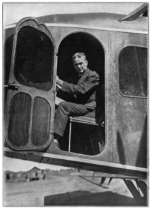 Alfred W. Lawson at the controls of his C-2, world's first airliner.