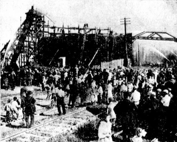 This June 7, 1911 Milwaukee Sentinel photograph shows the smoldering wreckage of the Center Street icehouse. Note the bridge over the railroad tracks that carried ice blocks to a loading dock.
