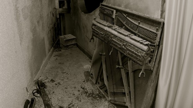 Built in the silent movie era, the Grand likely used a piano to provide accompanying music for the films. This shattered piano was pushed behind the screen and forgotten. Dan Soiney photo
