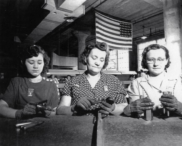Inspectors at the Milwaukee Ordinance Plant. The workers took up a collection to buy the silk American flag that decorates their workspace. Courtesy Milwaukee County Historical Society
