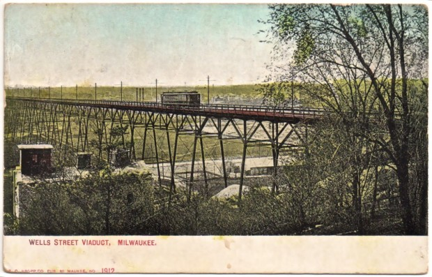 A postcard, dated 1909, shows a streetcar crossing the viaduct. The 2,085-foot-long Wells Street viaduct was the Milwaukee streetcar system's greatest engineering feat. Built in 1892, it remained in service until the end of trolley service in 1958. Carl A. Swanson collection