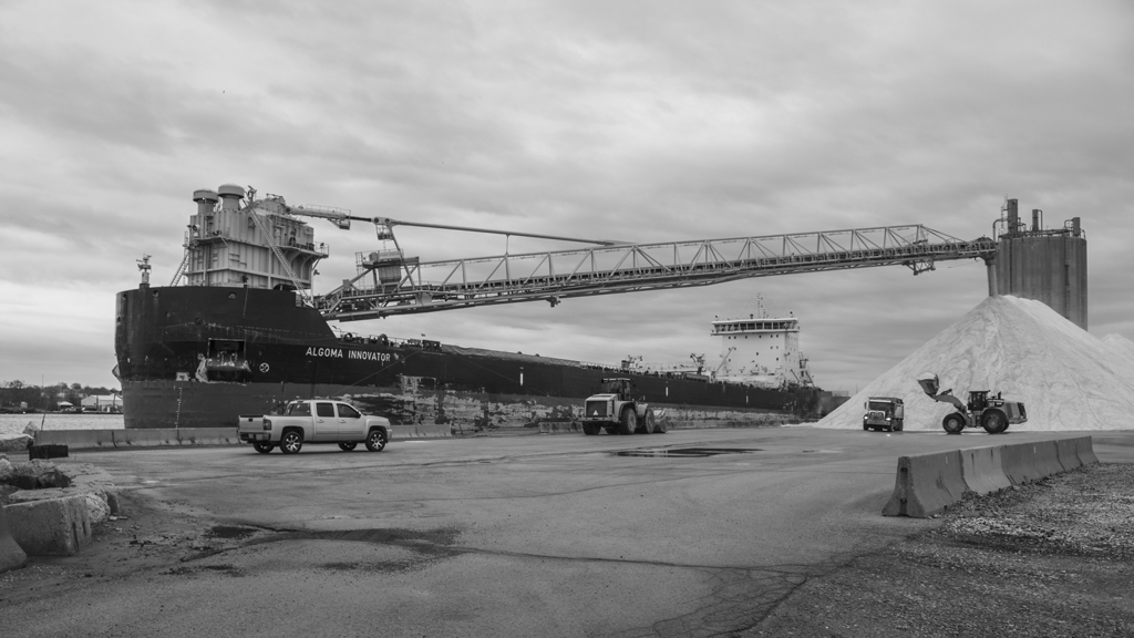 Recent photo of Algoma Innovator using a self-unloading boom to unload salt.