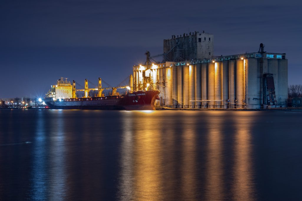 A nighttime photo showing a Canadian ship loading grain at the COFCO International grain elevator in Milwaukee